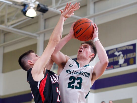Williamston's Cole Kleiver, right, goes up for a shot