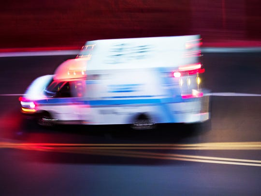 A file photo of an ambulance speeding along a street. The Washoe County Regional Medical Examiner's Office identified the man who died shortly after being pulled from the Truckee River on Sunday.