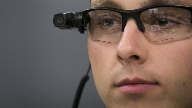 """Mesa officer Philip """"Mitch"""" Brailsford was among the first in his department to receive a body camera."""