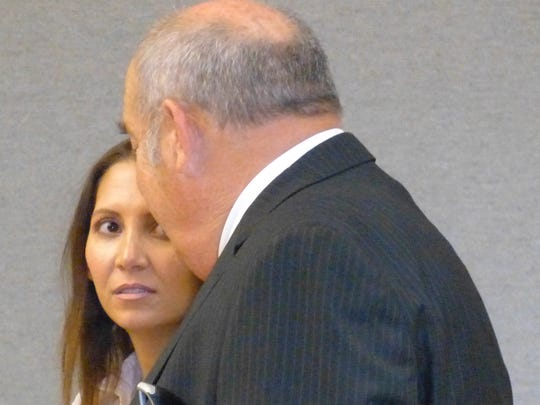 Jacqueline Bryce Herron listens to defense attorney Mark Daniel Melnick during her appearance Wednesday in Shasta County Superior Court.