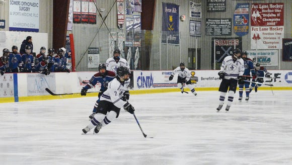 Max Klares (7) resets the power play for John Jay during