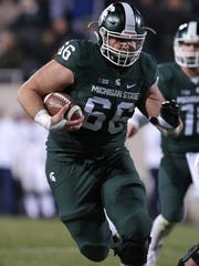 Michigan State offensive lineman Jack Allen runs for a touchdown against Penn State.