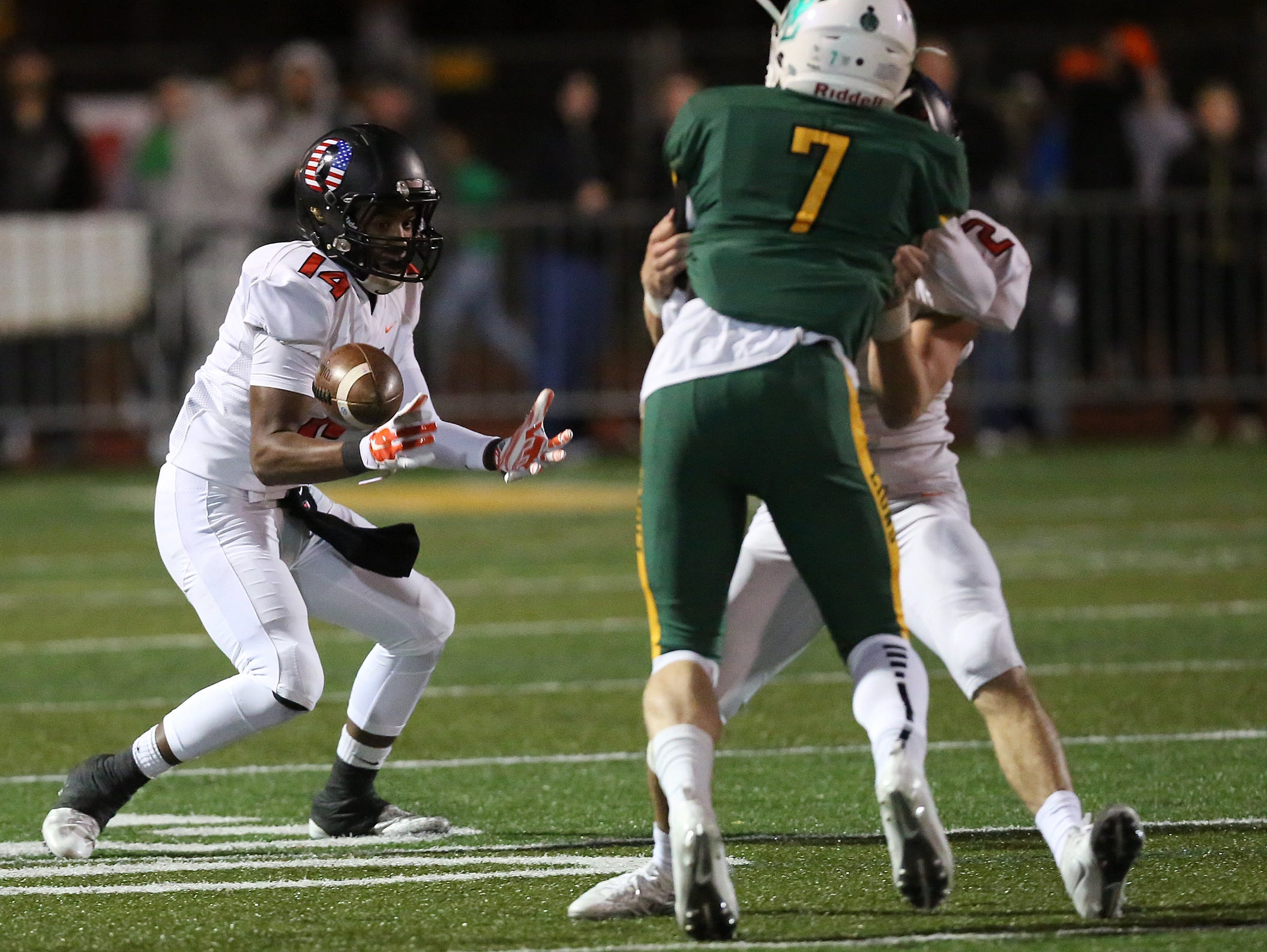Sprague's Jailen Hammer and the Olys fall to West Linn 56-20 in the OSAA Class 6A state quarterfinals on Friday, Nov. 18, 2016, at West Linn High School.