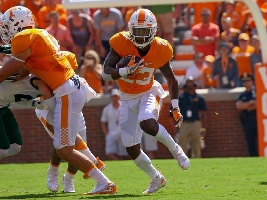 Tennessee defensive back Cameron Sutton (23) returns a kick against Ohio on Sept. 17, 2016.