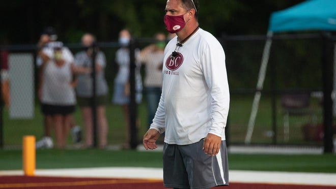 Benedictine's Head Coach Danny Britt safely watches the team compete during the recent Maroon vs. White Scrimmage at Father Albert Bickerstaff Field.