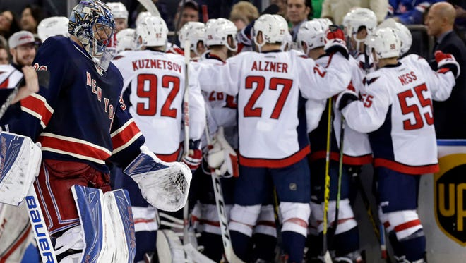 The Washington Capitals celebrate Alex Ovechkin's game-winning goal in overtime earlier this year against the New York Rangers.
