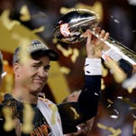 Denver Broncos' Peyton Manning holds up the trophy after the NFL Super Bowl 50 football game Sunday, Feb. 7, 2016, in Santa Clara, Calif. The Broncos won 24-10. (AP Photo/Matt York)