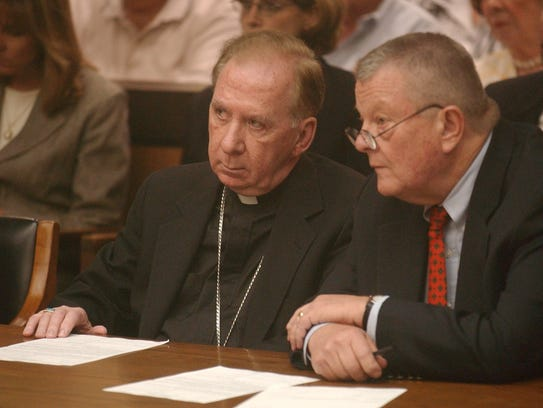 Bishop Thomas O'Brien (left), the former head of the