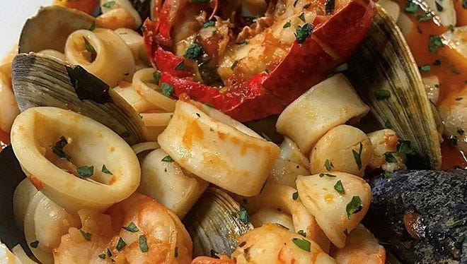 The zuppa di pesce with clams, mussels, calamari, shrimp, lobster tail, scallops, spicy marinara and basil at Saly G's.