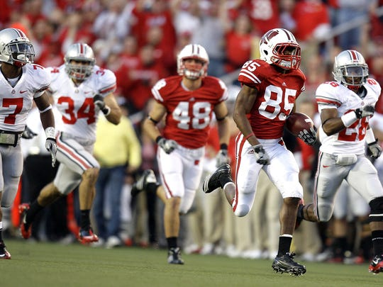 David Gilreath races 97 yards for a touchdown on the opening kickoff against Ohio State in 2010 at Camp Randall Stadium.