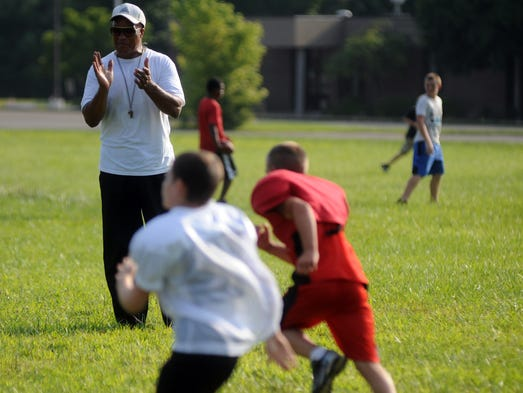 Fred Matthews coaches children during practice for the South Rebels. Matthews has been coaching youth football biddy league for 35 years.