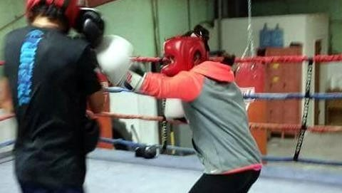 """Ricky Dozal Jr., left, and Marisol """"Dangerous"""" Denogean spar in preparation for the Henry Gutierrez Memorial Boxing Tournament slated for 2 p.m., Saturday, Dec. 3, 2016 at the Southwestern New Mexico State Fairgrounds, 4100 Raymond Reed Blvd."""