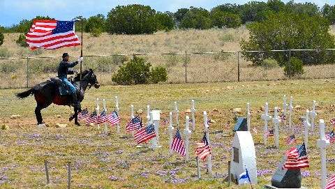Matthew Midgett and his horse Belle added a touch of history to the Memorial Day celebration at Fort Stanton.