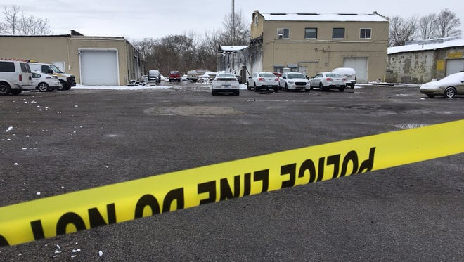 A body was found in a shallow grave at this business business in the 1200 block of West 29th Street.