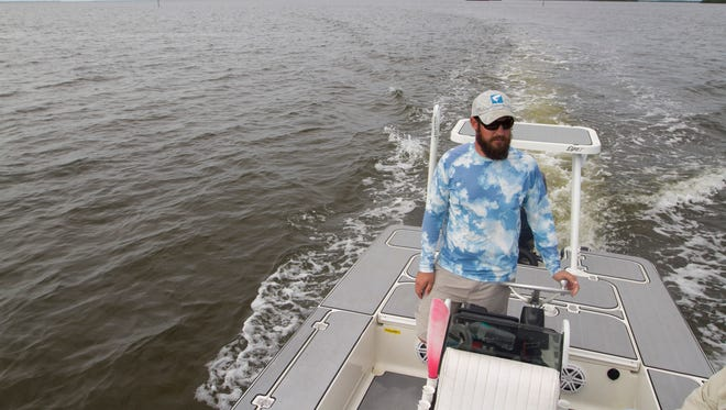 Fishing captain Daniel Andrews has been taking his fishing charters at least 20 miles north of Punta Rassa to find fish. The sea grass beds at the mouth of the Caloosahatchee are all dead, leaving no habitat for bait fish.