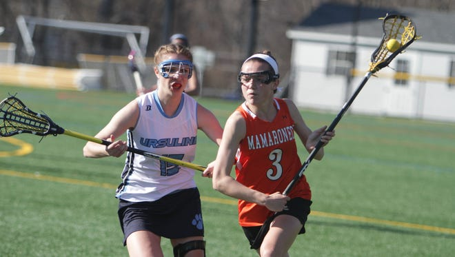 Mamaroneck's Madeline Riordan attempts to run past Ursuline's Madison Boutureira during a Section 1 girls lacrosse game between Ursuline and Mamaroneck at the Ursuline School on Thursday, April 14th, 2016. Mamaroneck won 12-10.