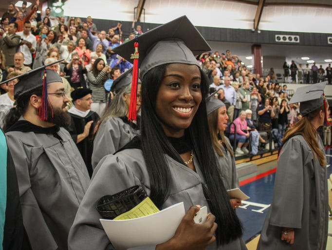 Lincroft,  NJ      Students file into he 2014 Brookdale Community College Commencement ceremony that took place at the Collins Arena on the Lincroft campus.  051714 Photo: Tom Spader/Staff Photographer