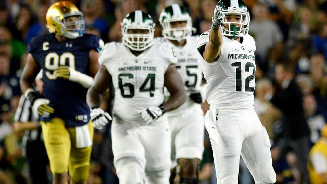 Michigan State University  senior receiver R.J. Shelton (12) signals for a first down after diving for a catch in the first half of the Spartans game against Notre Dame Saturday, Sept. 17, 2016 in South Bend, Ind.
