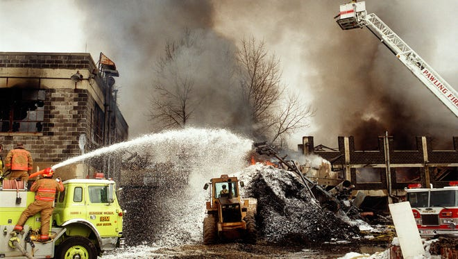 Firefighters work a fire at the Mid-Hudson Recycling Park in the Town of Dover on January 1, 1996.