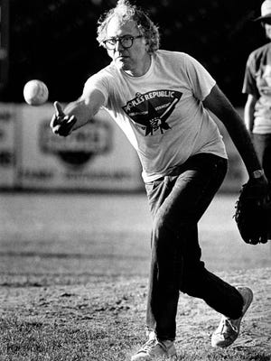 "The original caption on this July 25, 1984, photo reads: ""Mayor Bernie Sanders delivers the softball to the plate during the City Hall vs Downtown Development Association softball match played at Centennial Field."""