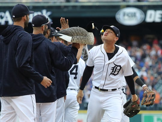 "JaCoby Jones, right, celebrates the Detroit Tigers' 7-4 win over the Toronto Blue Jays with a kiss to the ""rally goose"" at Comerica Park on June 2, 2018 in Detroit."