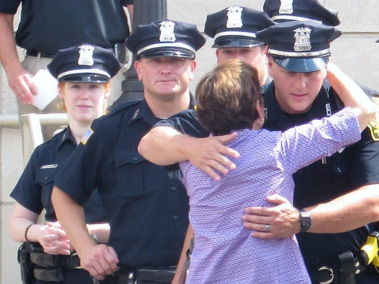 Retiring Elmira Police Department employee Yolanda Lopez greets officers following her walk-out ceremony Friday at Elmira City Hall.