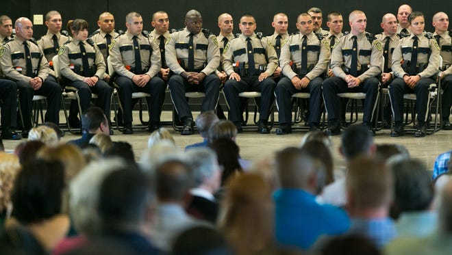 Loved ones watch as Doña Ana County Sheriff's cadets graduate at the  Doña Ana Community College auditorium during DASO's 21st Law Enforcement Academy Graduation Ceremony on Thursday, Feb. 25, 2016.