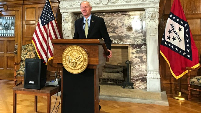 Arkansas Gov. Asa Hutchinson speaks to reporters on Wednesday, May 3, 2017, in Little Rock about the end of a special legislative session that had focused on changes to the state's hybrid Medicaid expansion. Lawmakers approved a plan allowing the state to pursue new restrictions to the program that would move 60,000 people off the expanded coverage and would require some remaining participants to work. Hutchinson had sought the changes and plans to sign the measures into law.