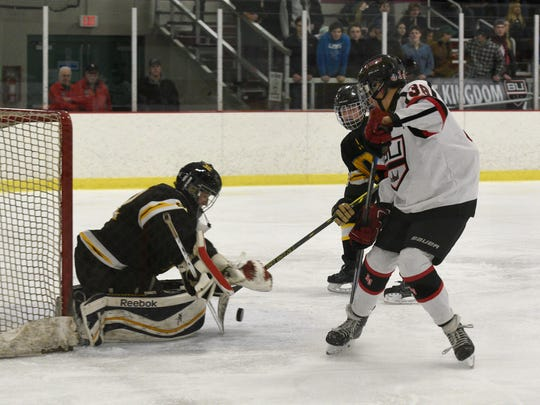 BU's Matthew Bachand gets a shot on goal during a game against Oxford-Avondale.