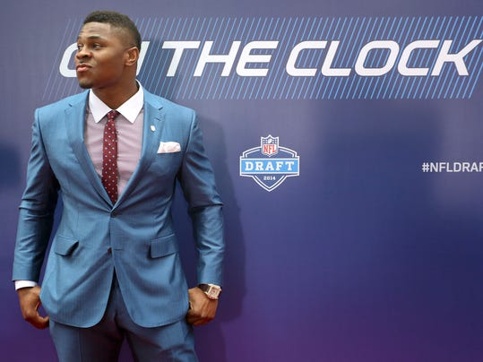 Buffalo linebacker Khalil Mack poses for photos on the red carpet upon arriving for the first round of the 2014 NFL Draft, Thursday, May 8, 2014, in New York. (AP Photo/Craig Ruttle)