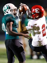 North High School's Keshon Waits (10) defends as East's