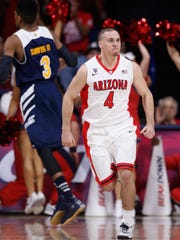 Arizona point guardT.J. McConnell reacts after hitting