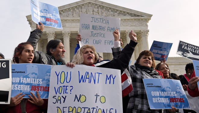 In this Jan. 15, 2016, file photo, members of CASA de Maryland participate in a immigration rally outside the Supreme Court in Washington. By agreeing to hear a challenge to Obama's immigration plan, the Supreme Court on Tuesday, Jan. 18, 2016, raised hopes that Obama may have one last chance to make good on an unfulfilled promise to millions of immigrants, many of whom feel abandoned by his administration's recent deportation raids. (AP Photo/Susan Walsh, File)