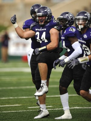 Thomas Metthe/Reporter-News Abilene Christian linebacker Sam Denmark (34) celebrates after one of his two interceptions in the game during the second quarter of the Wildcats' 21-0 win on Saturday, Sept. 20 2014, at Shotwell Stadium.