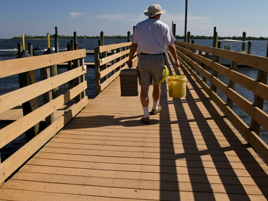 A visitor to Cayo Costa State Park makes his way down