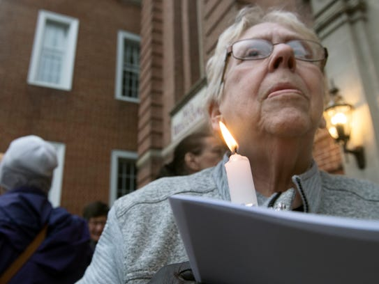 Lynne Newman helped to organize a candlelight vigil