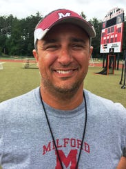 Dan Novak is the first-year head football coach at