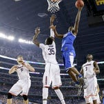 Kentucky forward Julius Randle (30) shoots over Connecticut center Amida Brimah (35) as Niels Giffey (5) and Terrence Samuel (3) look on during the first half of the NCAA Final Four tournament college basketball championship game Monday, April 7, 2014, in Arlington, Texas. (AP Photo/Eric Gay)