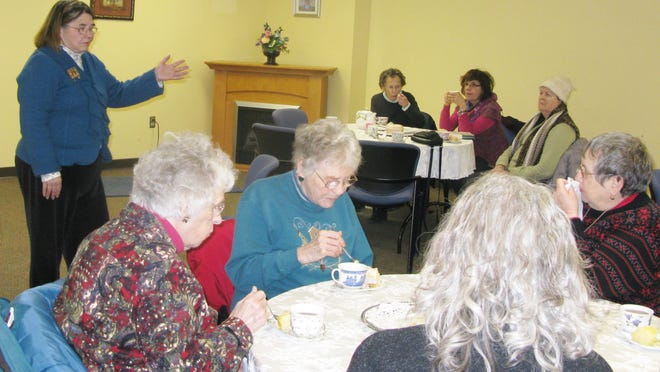 """Librarian Camille DelVechio addresses a typical group at the """"Wednesday Tea."""" This group heard about Barbara Kingsolver's book, """"Flight Behavior."""""""