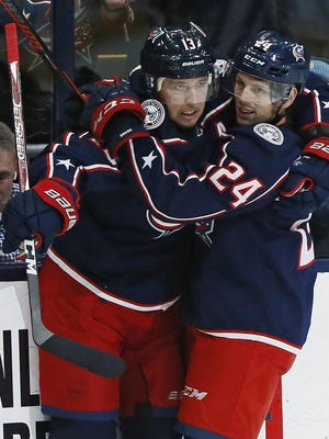 Cam Atkinson, left, and Nathan Gerbe are among the injured Blue Jackets players who were able to get healthy during the NHL's coronavirus shutdown. The Blue Jackets are scheduled to take on Toronto when the Stanley Cup Playoffs begin, likely in July.
