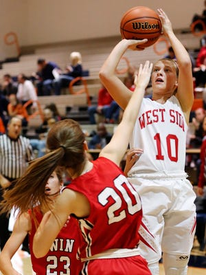 West Lafayette's Abby Martin put up a shot over Katie Hattabaugh of Twin Lakes Tuesday, November 17, 2015, in the girls J&C Hoops Classic at Harrison High School. West Lafayette defeated Twin Lakes 67-34.