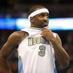 Jan 25, 2015; Denver, CO, USA; Denver Nuggets guard Ty Lawson (3) reacts during the second half against the Washington Wizards at Pepsi Center. The Wizards won 117-115. Mandatory Credit: Chris Humphreys-USA TODAY Sports