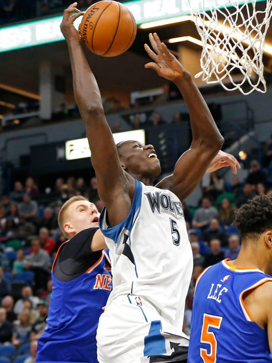 Minnesota Timberwolves' Gorgui Dieng, left, of Senegal ,loses control of the ball as New York Knicks' Kristaps Porzingis, left, of Latvia defends during the first quarter of an NBA basketball game, Wednesday, Nov. 30, 2016, in Minneapolis. (AP Photo/Jim Mone)