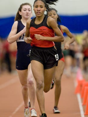 Neptune's Ajee Wilson runs with pack before extending lead to win the Group II 1600. NJSIAA Group II - III Track Championships - Toms River