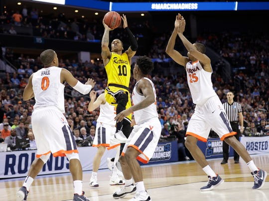 UMBC's Jairus Lyles (10) shoots against Virginia during the second half of a first-round game in the NCAA men's college basketball tournament in Charlotte, N.C., Friday, March 16, 2018. (AP Photo/Gerry Broome)