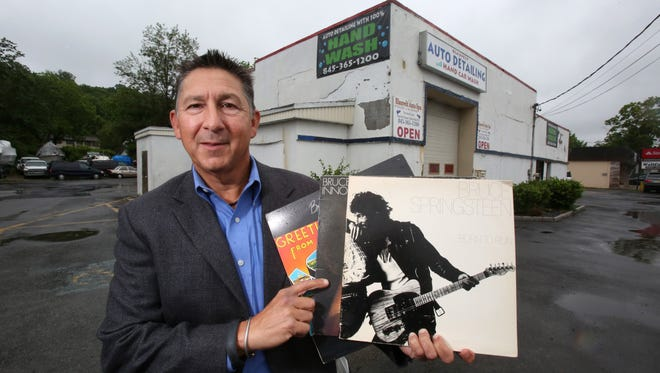 Michael Magnone of New City with his copies of Bruce Springsteen's first three albums at the Blauvelt Auto Spa. Magnone wants to put up a historical marker at the site, originally the 914 Sound Studios, where the first two albums and the title track of the third were recorded.