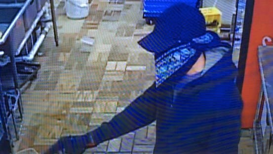 A suspect is seen robbing a Melbourne Domino's Pizza on Saturday, April 23, 2016.