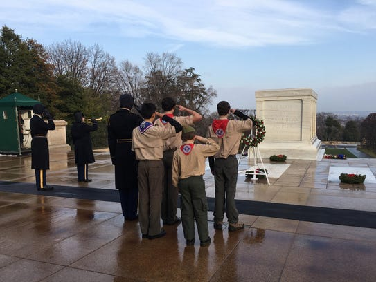 Scouts from Boy Scout Troop 61 lay a wreath at the