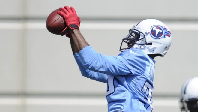 Cornerback Marc Anthony makes a catch during Titans minicamp on June 19.