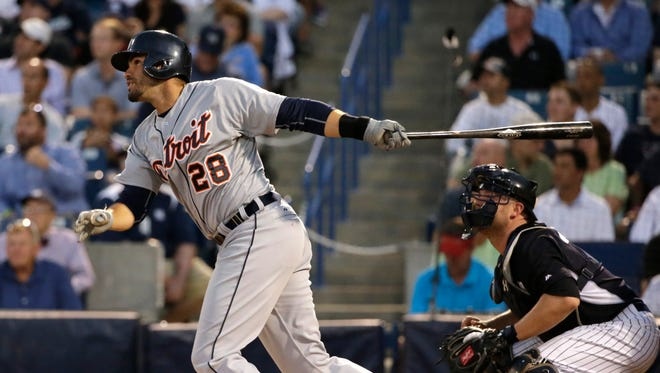 Detroit Tigers J.D. Martinez watches his second-inning two-run double off New York Yankees starting pitcher Esmil Rogers in a spring training baseball game in Tampa, Fla., Tuesday, March 24, 2015.